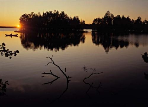 Fisherman's boat against rising sun
